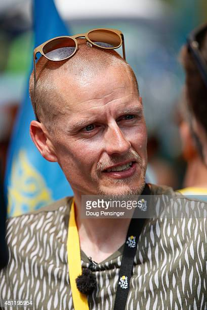 Retired cyclist Michael Rasmussen attends the start of stage 14 during the 2014 Tour de France a 1875km stage from Rodez to Mende on July 18 2015 in...