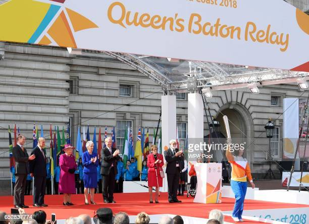 Retired cysclist Anna Mears from Australia carries the baton after receiving it from Queen Elizabeth during the launch of The Queen's Baton Relay for...