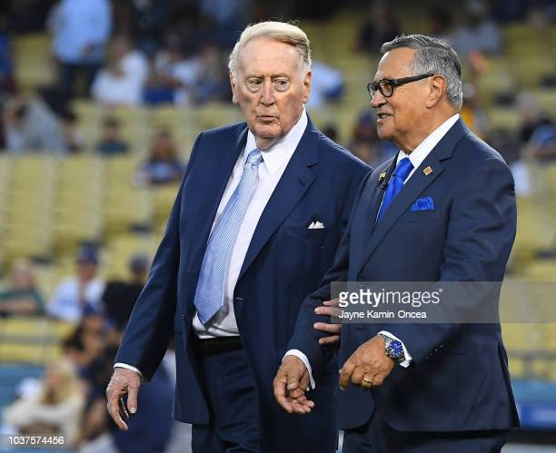 Retired Dodgers broadcaster Vin Scully left jokes with Dodgers Spanish language broadcaster Jaime Jarrin during a pregame ceremony inducting Jarrin...