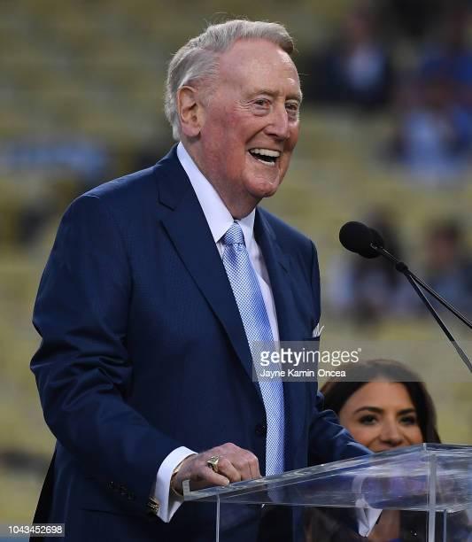 Retired Dodgers broadcaster Vin Scully left speaks during a pregame ceremony honoring language broadcaster Jaime Jarrin inducting him into the Dodger...