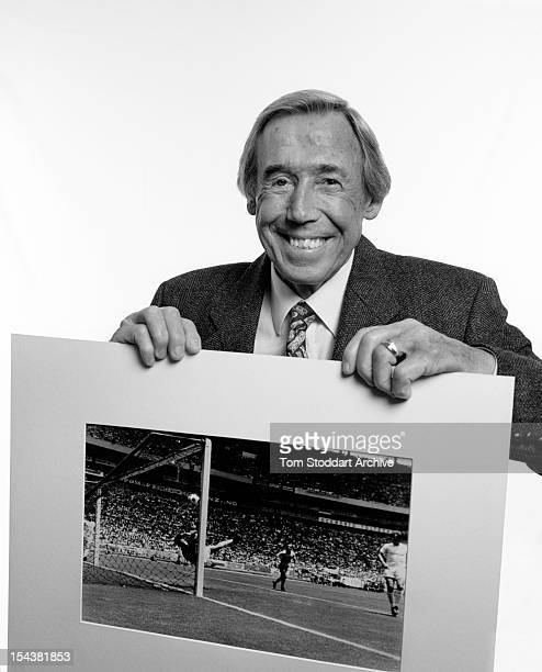 Retired English football goalkeeper Gordon Banks OBE London January 2010 He is holding a photograph of one of his most famous moments which occurred...