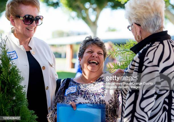 Retired Estock Elementary teachers Pat Hayward left Carol TraxMotes right share memories with former student Libby Logan center during the Helen...