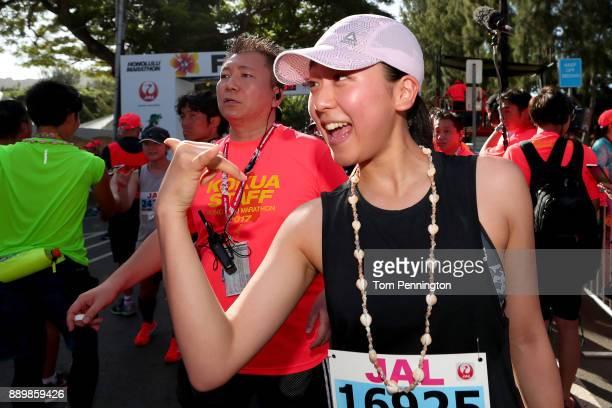 Retired figure skater and former Olympian Mao Asada celebrates after completing the Honolulu Marathon 2017 on December 10 2017 in Honolulu Hawaii