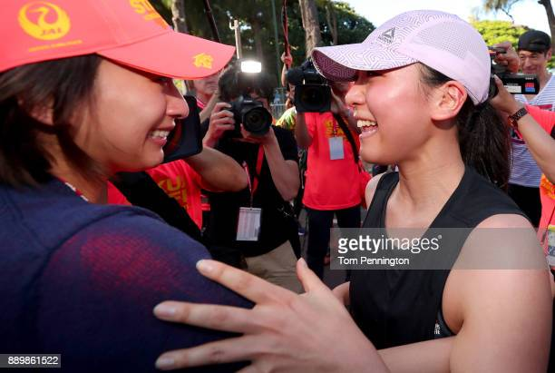 Retired figure skater and former Olympian Mao Asada celebrates with her sister Mai Asada after completing the Honolulu Marathon 2017 on December 10...