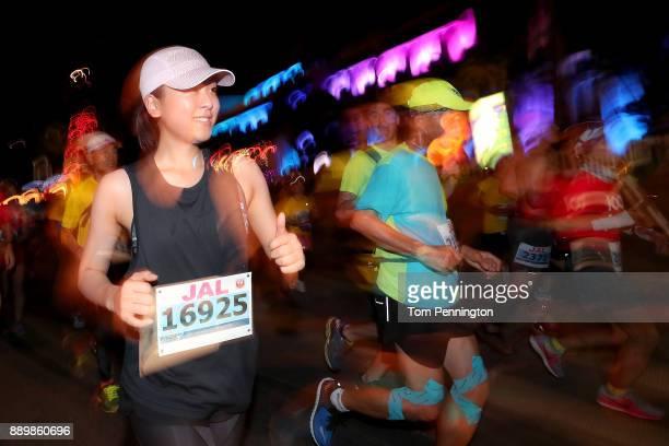 Retired figure skater and former Olympian Mao Asada runs in the Honolulu Marathon 2017 on December 10 2017 in Honolulu Hawaii