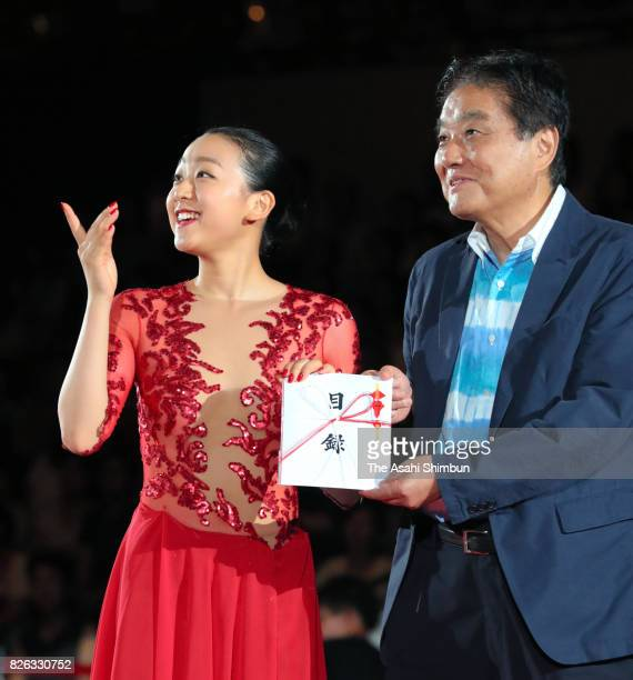 Retired figure skater Mao Asada and Nagoya City Mayor Takashi Kawamura are seen during an ice show at Aichi Prefecture Gymnasium on August 4 2017 in...