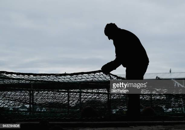 A retired fisherman mends fishing nets as fishing boats gather on the River Tyne in North Shields as fishermen take part in a nationwide protest...
