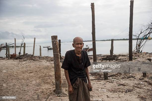 A retired fisherman poses for a portrait outside his home near the planned Dawei SEZ on August 3 2015 in Pantininn Myanmar The controversial...