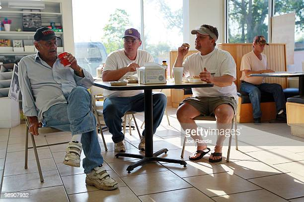 Retired fisherman Walter Nunez sits with fishermen Steve Mitchell and Anthony Lee as they pass the time at Kent Sue's Quick stop Deli store on May 7...