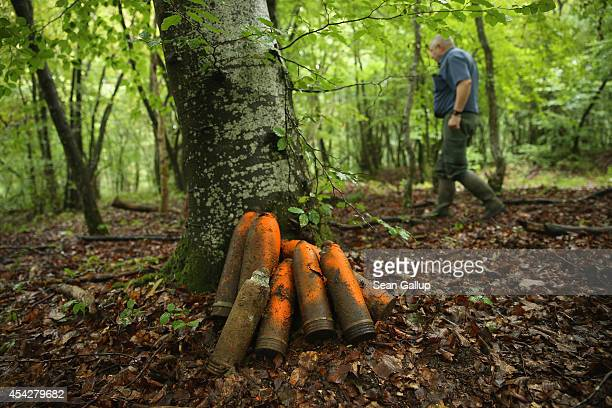Retired forest services worker Daniel Gadois walks past German 77mm and 105mm artillery shells that date from World War I and were never fired that...