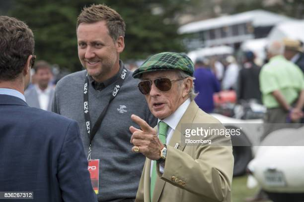 Retired Formula One race car driver Jackie Stewart right speaks with attendees as professional golfer Ian Poulter stands during the 2017 Pebble Beach...