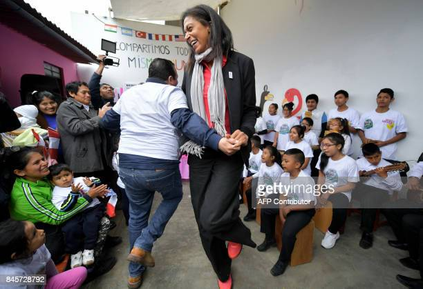 Retired French basketball player Emmeline Ndongue dances during a visit of the Paris 2024 Olympic bid to a humanitarian project at the Collique...