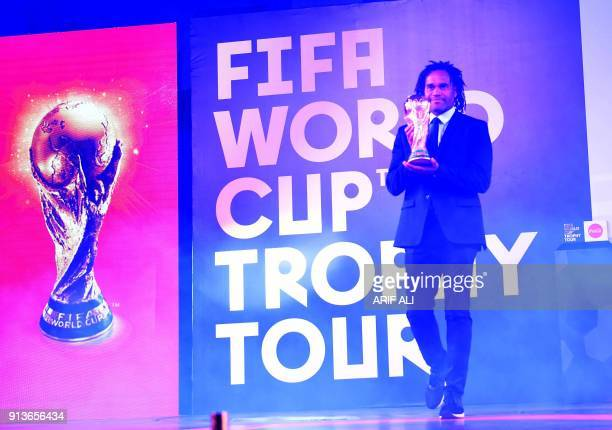 Retired French footballer Christian Karembeu holds the FIFA World Cup Trophy during a ceremony in Lahore on February 3 2018 The FIFA World Cup Trophy...