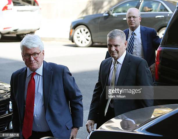 Retired Gen James Cartwright arrives for a hearing with his attorney Greg Craig at US District Court October 17 2016 in Washington DC Cartwright has...