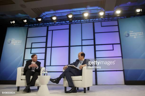 Retired General David Petraeus chairman of KKR Global Institute speaks while Michael Milken chairman of the Milken Institute right listens during the...