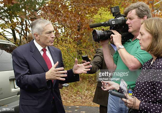 Retired General Wesley Clark a democratic candidate for president in 2004 talks with reporters October 29 2003 at a campaign stop in Exeter New...