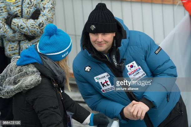 Retired German bobsledder and South Korea's coach André Lange stands in the finishing area during the first round of the men's double seater at the...