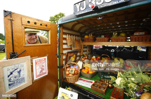 Retired grocer Mervyn Hoyle from Thirsk checks his display of produce in the back of his Austin Seven van before judging at the 50th Austin Seven...