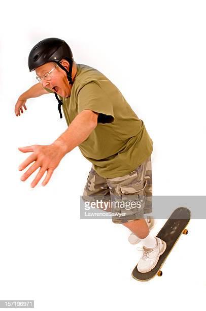 retired guy falls off his skateboard