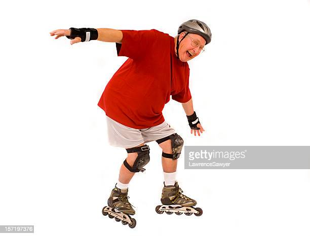 retired guy goes inline skating - inline skating stock pictures, royalty-free photos & images
