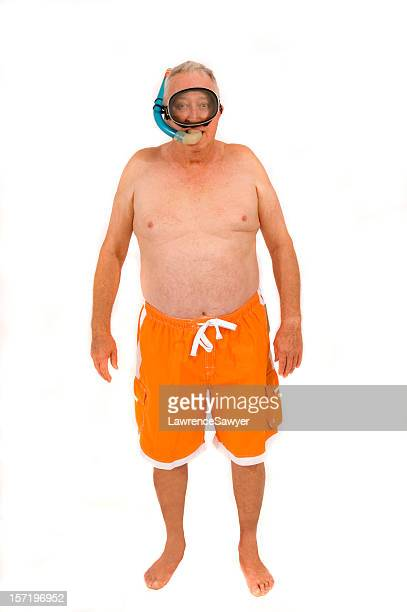 retired guy goes snorkeling - zwembroek stockfoto's en -beelden