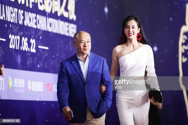 Retired gymnast and entrepreneur Li Ning yoga model and actress Miya Muqi arrive at the red carpet of Gala Night of Jackie Chan Action Movie Week...