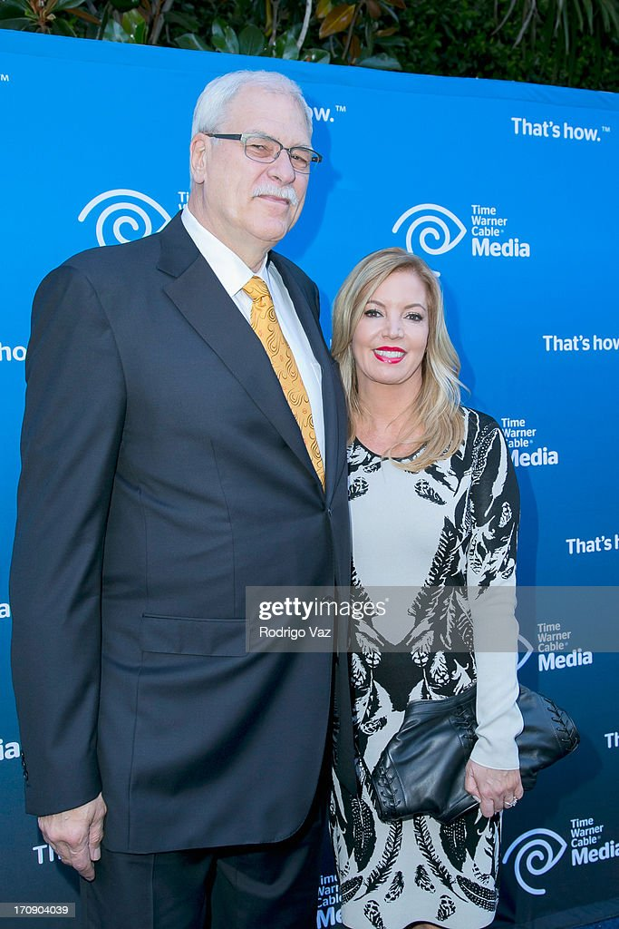 Retired head coach of LA Lakers and Chicago Bulls Phil Jackson (L) and LA Lakers EVP Jeanie Buss attend the Time Warner Cable Media (TWC Media) 'View From The Top' Upfront at Vibiana on June 19, 2013 in Los Angeles, California.