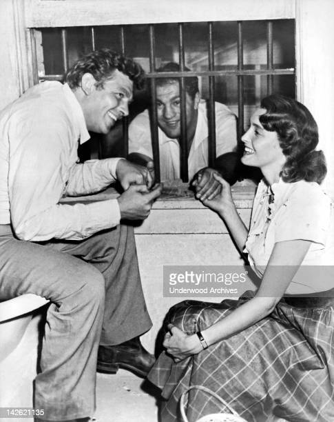 Retired heavyweight champion Rocky Marciano gets consoled on the set of 'A Face In The Crowd' by stars Andy Griffith and Patricia Neal Hollywood...