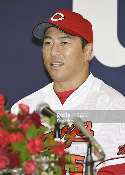 Retired Hiroshima Carp righthander Hiroki Kuroda attends a press conference in the western Japan city of Hiroshima on Nov 4 2016 Kuroda who spent...