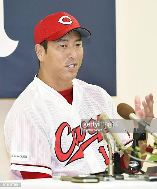 Retired Hiroshima Carp righthander Hiroki Kuroda attends a press conference in the western Japan city of Hiroshima on Nov 4 2016 Kuroda who spent...