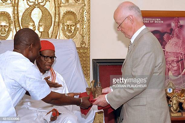 Retired hospital consultant Mark Walker hands over two bronze artefacts he returned to the Benin kingdom to the Oba of Benin, Uku Akpolokpolo...