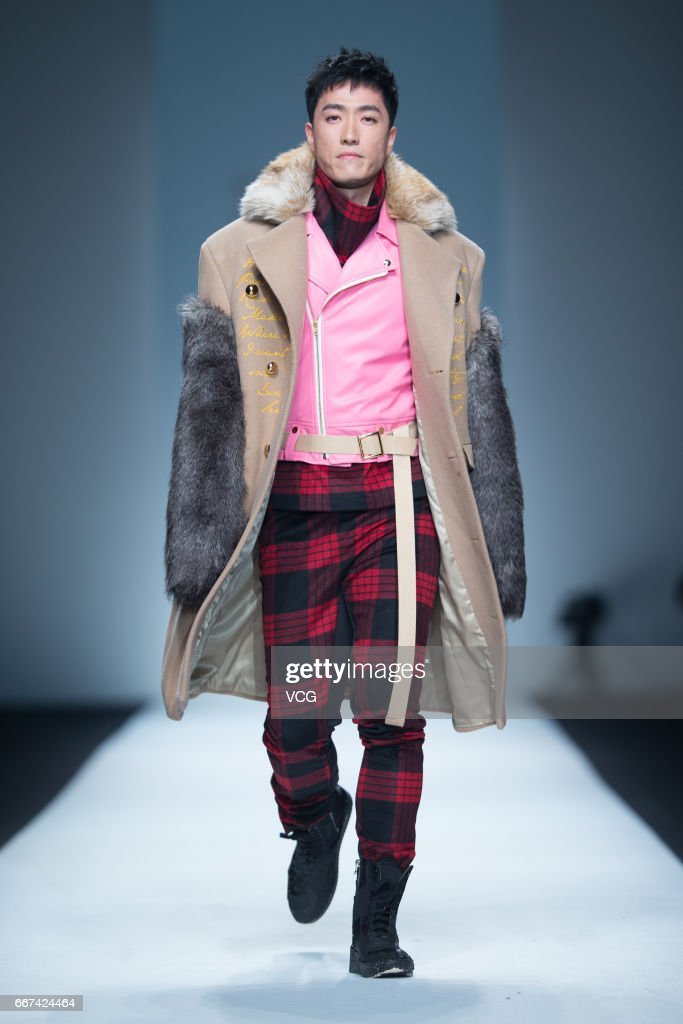 Retired hurdler Liu Xiang showcases designs on runway at the SOLO CELEB. & HTDG collection by Leo Ku during Shanghai Fashion Week Autumn/Winter 2017 at Xintiandi on April 11, 2017 in Shanghai, China.