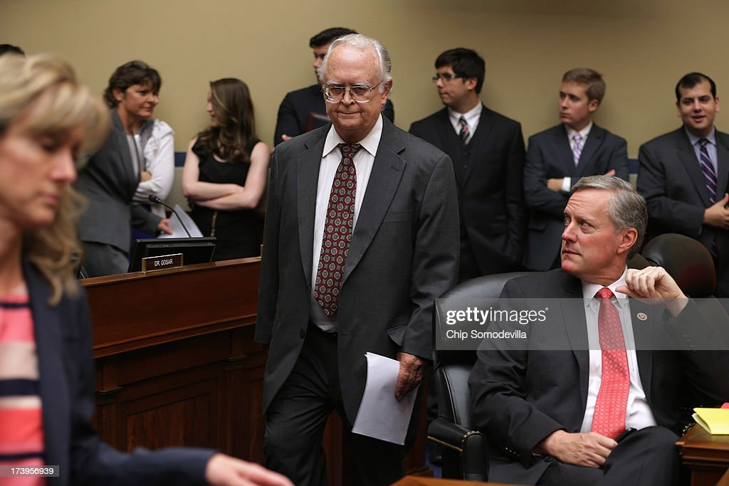 Retired Internal Revenue Service tax law specialist Carter Hull (C) arrives before testifying to the House Oversight and Government Reform Committee in the Rayburn House Office Building on Capitol Hill July 18, 2013 in Washington, DC. Hull testified as part of the committee's ongoing investigation into claims that the IRS systematically delayed and scrutinized applications for tax exempt status from organizations with the words 'Tea Party' and 'patriot' in their names.