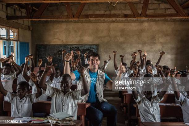 Retired Irish rugby player and UNICEF Ambassador Donncha O'Callaghan poses for a picture in a classroom of children being taught about the symptoms...