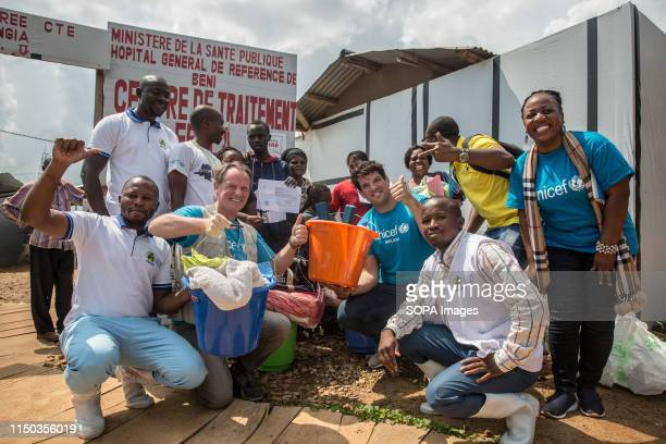 Retired Irish rugby player and UNICEF ambassador Donncha o'Callaghan poses for a picture outside an Ebola treatment centre with a team from Unicef...