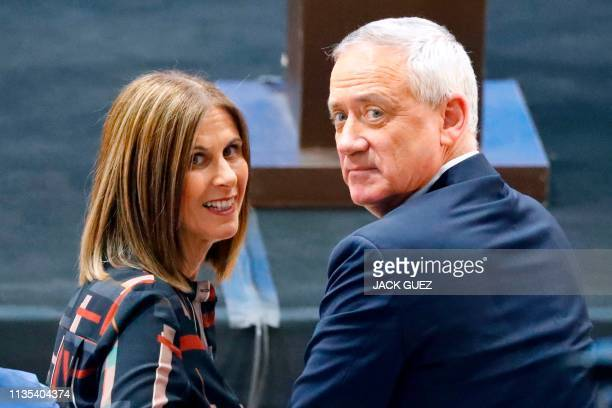 Retired Israeli general Benny Gantz one of the leaders of the Blue and White political alliance and his wife Revital look on during a campaign event...