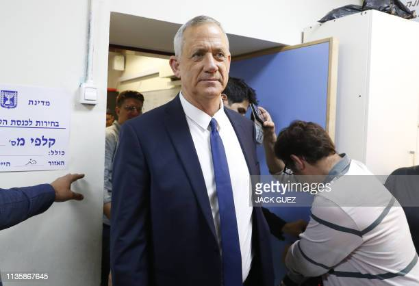 Retired Israeli general Benny Gantz one of the leaders of the Blue and White political alliance arrives to cast his vote during Israel's...