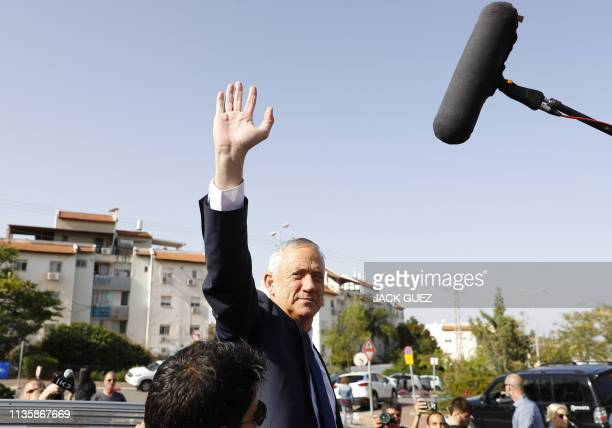Retired Israeli general Benny Gantz one of the leaders of the Blue and White political alliance waves after casting his vote during Israel's...