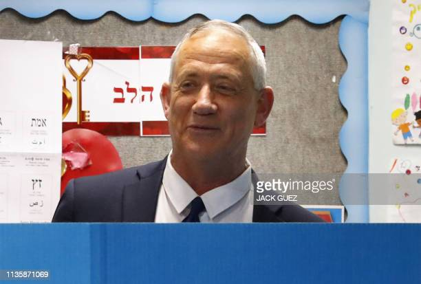 Retired Israeli general Benny Gantz one of the leaders of the Blue and White political alliance casts his vote during Israel's parliamentary...