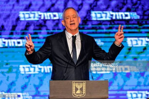 Retired Israeli general Benny Gantz one of the leaders of the Blue and White political alliance flashes the victory gesture with both hands as he...