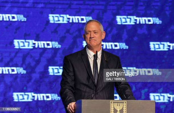 Retired Israeli general Benny Gantz one of the leaders of the Blue and White political alliance appears before supporters at the alliance...