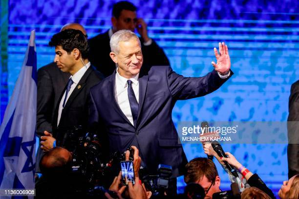 Retired Israeli general Benny Gantz one of the leaders of the Blue and White political alliance greets supporters at the alliance headquarters in Tel...