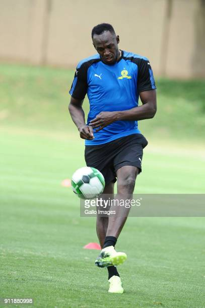 Retired Jamaican athletic superstar Usain Bolt joins the Mamelodi Sundowns Training Session at Chloorkop on January 29, 2018 in Pretoria, South...