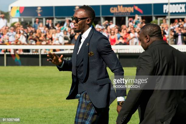 Retired Jamaican Olympic and World champion sprinter Usain Bolt arrives for the start of the Met horse race at Kenilworth race track on January 27 in...