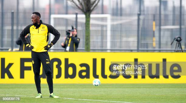 TOPSHOT Retired Jamaican Olympic and World champion sprinter Usain Bolt looks on as he takes part in a training session of German first Bundesliga...
