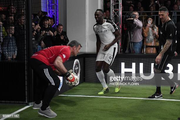 Retired Jamaican Olympic and World champion sprinter Usain Bolt takes part in an exhibition football game organised by watchmaker Hublot during the...