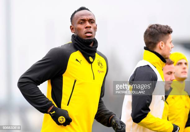 Retired Jamaican Olympic and World champion sprinter Usain Bolt takes part in a training session of German first Bundesliga football team Dortmund on...