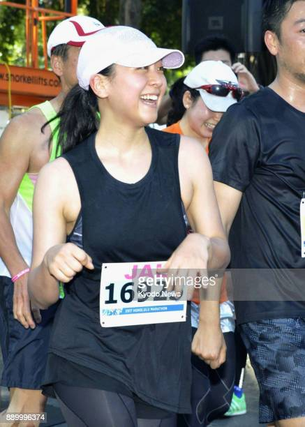 Retired Japanese figure skater Mao Asada smiles after completing her first fulldistance marathon in Honolulu on Dec 10 2017 The former world champion...