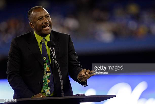 Retired Jay Joe Carter speaks during a pregame ceremony for retiring Manager Cito Gaston of the Toronto Blue Jays as they play the New York Yankees...