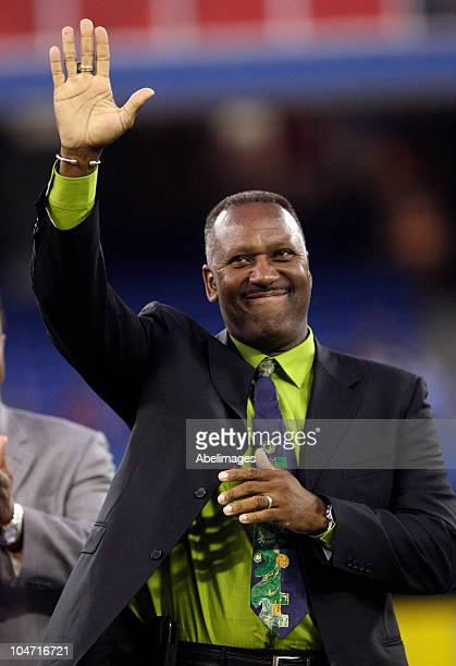 Retired Jay Joe Carter waves during a pregame ceremony for retiring Manager Cito Gaston of the Toronto Blue Jays as they play the New York Yankees...